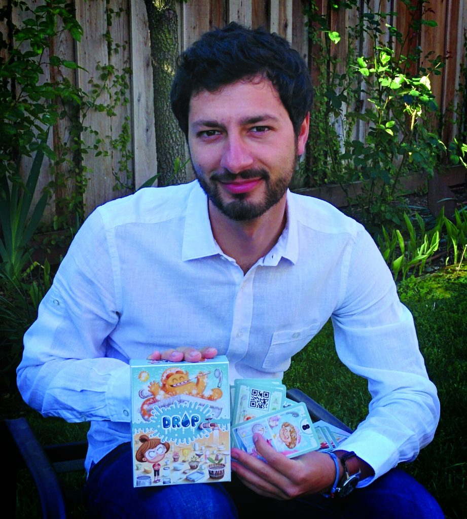 Andrea Cominola, holding a water conservation game designed by Spartaco Albertarelli, founder of KaleidosGames © Andrea Cominola